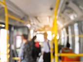 Blurred people standing on the bus