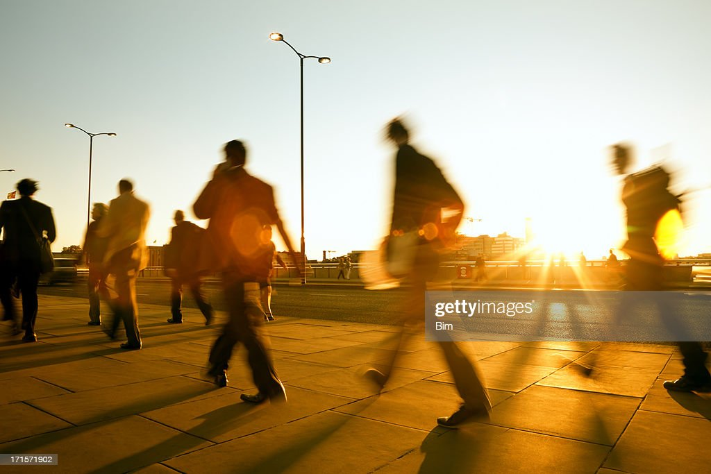 Business People Walking in Sunset Light