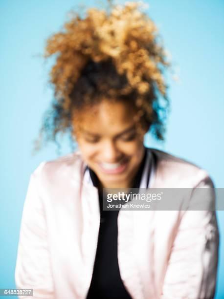 Blurred portrait,dark skinned female, looking down