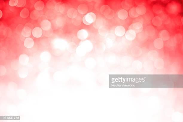Blurred red sparkles with dark top corner