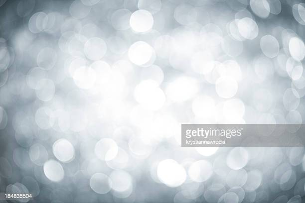 Blurred silver sparkles with darker corners and bright center