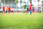 Blurred soccer practice court and athlete motion blur for background design material