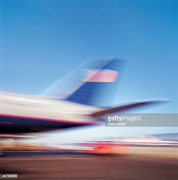 Blurred Tail Wing of a Commerical Aeroplane on a Runway
