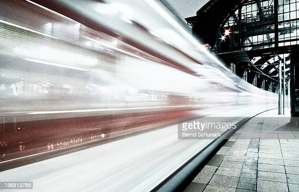 Blurred train at night leaving station