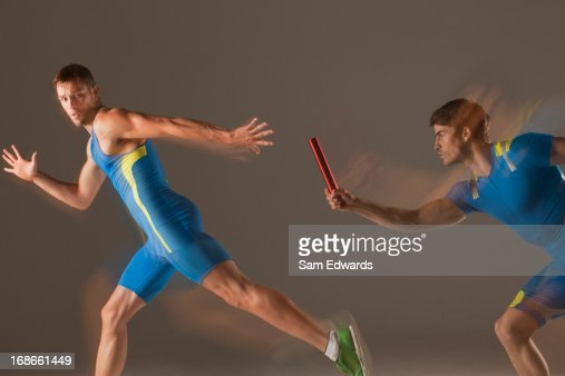 Blurred view of athletes passing baton : Stock Photo