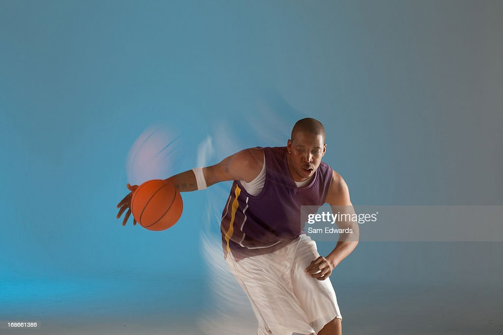 Blurred view of basketball player dribbling : Stock Photo