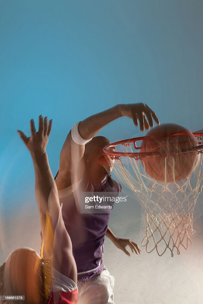 Blurred view of basketball player dunking : Stock Photo