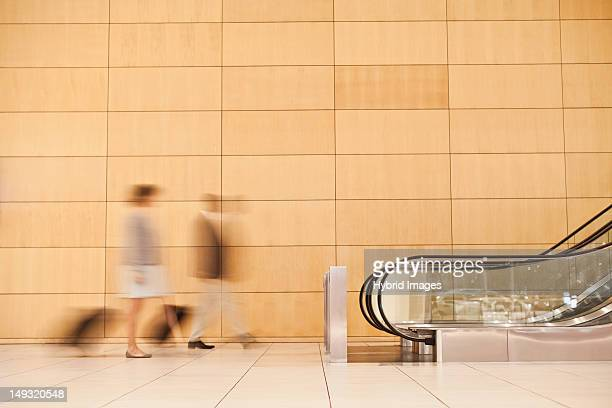 Blurred view of business people in lobby