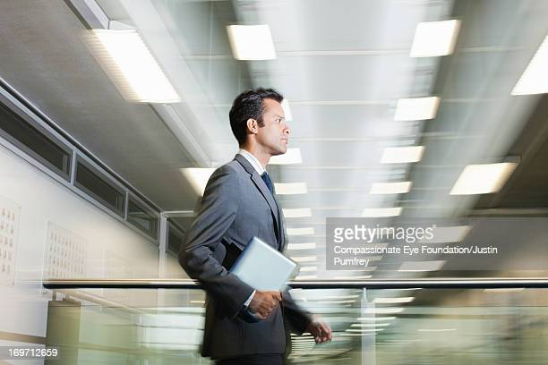 Blurred view of businessman walking in office