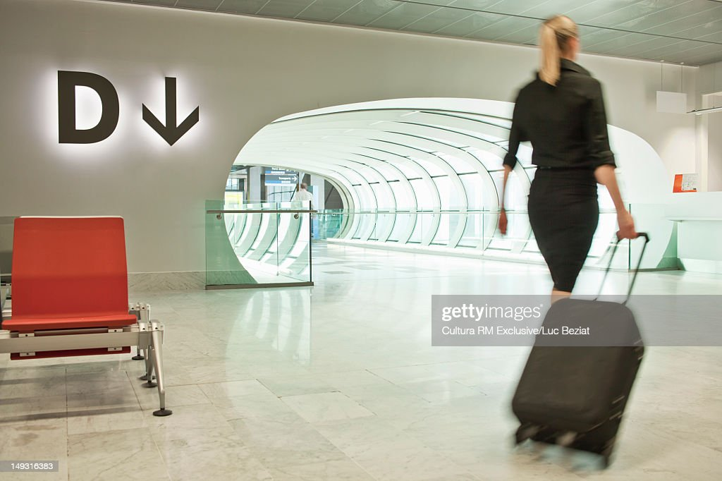 Blurred view of businesswoman in airport