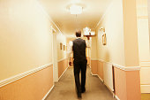 Blurred view of Caucasian butler carrying tea in hotel hallway