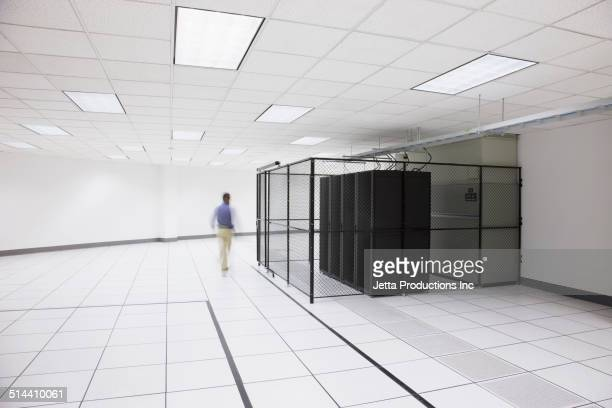 Blurred view of Chinese businessman in server room
