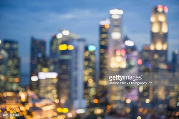 Blurred view of city skyline lit up at night, Singapore