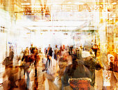 Blurred view of people walking in busy lobby