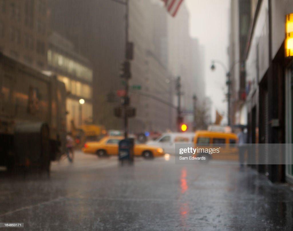 Blurred view of rainy city street