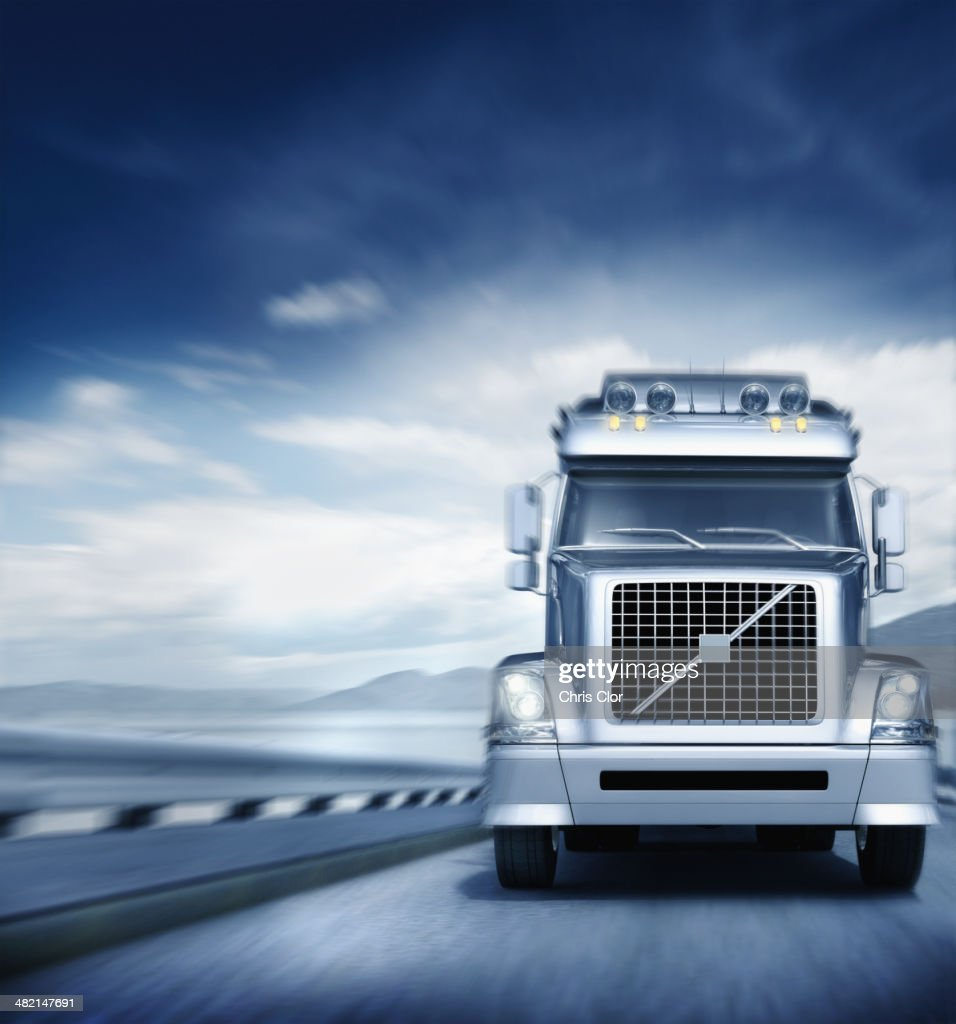 Blurred view of semi-truck driving on freeway : Stock Photo
