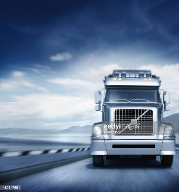 Blurred view of semi-truck driving on freeway