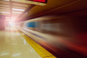 Blurred view of train leaving platform