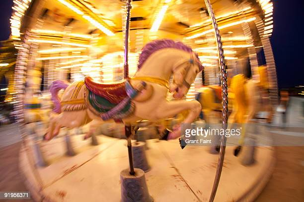 blurring carosel horse at dusk