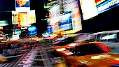 Blurring lights of downtown Times Square, New York City, USA.