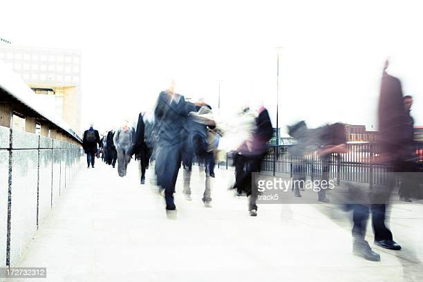 Blurry motion shot of business people walking on street.