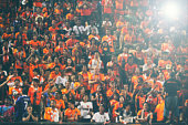 blurry of Soccer fans in a match and Spectators at football stadium