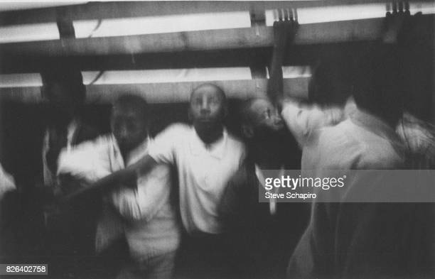 Blurry view of child migrant farm workers in the back of a moving truck Fort Smith Arkansas 1961