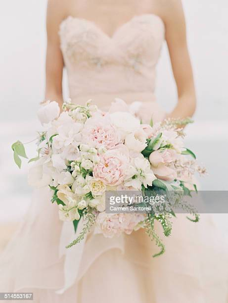 Blush bridal bouquet held by a bride