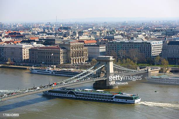 PAINS 'Blythe Spirits' Episode 502 Pictured View of The Chain Bridge crossing the Danube River with the Hungarian Academy of Sciences building and...
