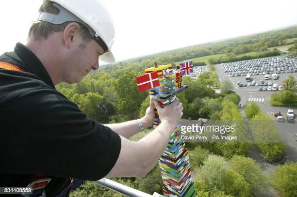 Bo Dahl Knudsen places the final bricks on the LEGO tower which is thought to have broken the world record for the tallest tower made from LEGO...