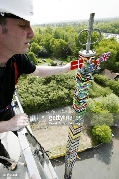 Bo Dahl Knudsen places the final bricks to break the world record for the tallest tower of Lego ever LEGOLAND Windsor