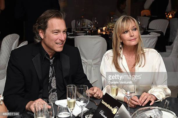 Bo Derek and John Corbett attend a Gala Dinner during the 60th Taormina Film Fest at Hotel Imperiale on June 18 2014 in Taormina Italy