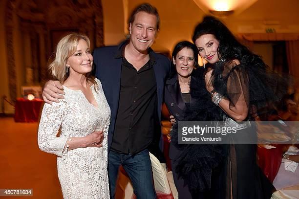 Bo Derek John Corbett Debra Mace and Lamia Khashoggi attend the Eva Longoria Foundation Dinner Gala during the 60th Taormina Film Fest at Hotel San...