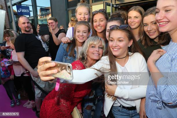 Bo Derek takes a selfie with fans during the late night shopping at Designer Outlet Soltau on August 4 2017 in Soltau Germany