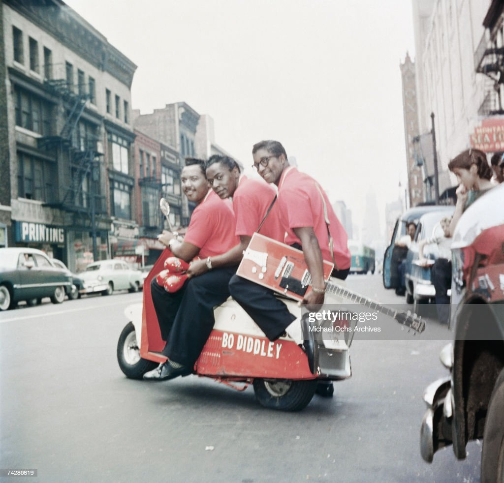Bo Diddley (on the back of the scooter) poses for a portrait with his band including Jerome Green (in center) in September 1959 in New York City, New York.