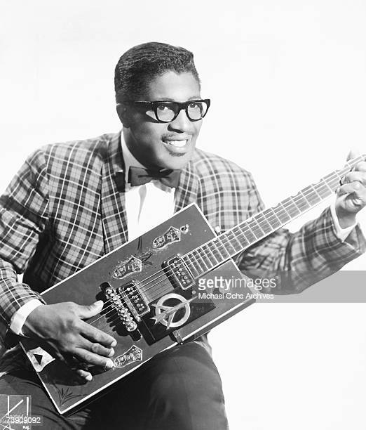 Bo Diddley poses for a portrait with his trademark square Gretsch electric guitar in circa 1957 in New York City New York