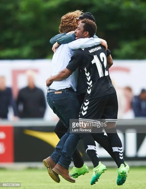 Bo Henriksen head coach of AC Horsens and Joseph Mensah of AC Horsens celebrate after the Danish Alka Superliga Playoff match between Vendsyssel FF...