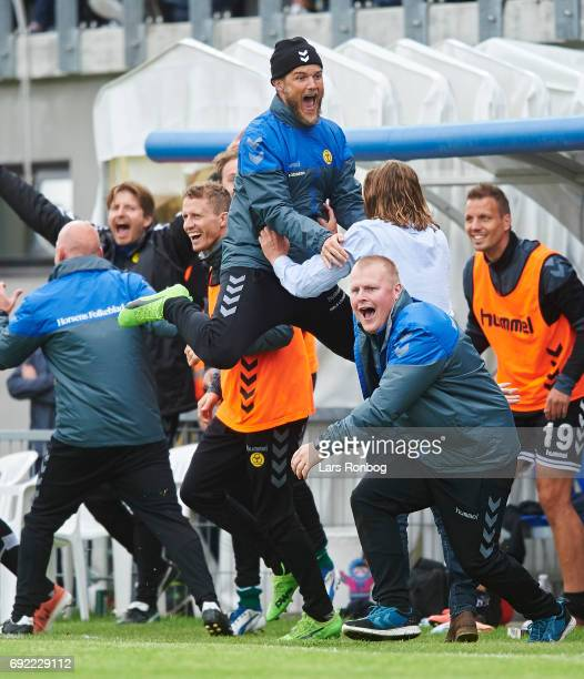 Bo Henriksen head coach of AC Horsens and Niels Lodberg assistant coach of AC Horsens celebrate after scoring their third goal during the Danish Alka...