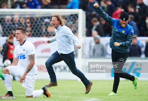 Bo Henriksen head coach of AC Horsens and Niels Lodberg assistant coach of AC Horsens celebrate after the Danish Alka Superliga Playoff match between...