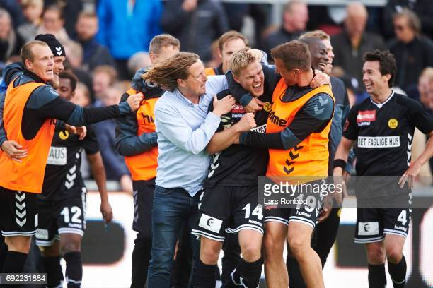Bo Henriksen head coach of AC Horsens Jonas Gemmer of AC Horsens and Kim Aabech of AC Horsens celebrate after the Danish Alka Superliga Playoff match...