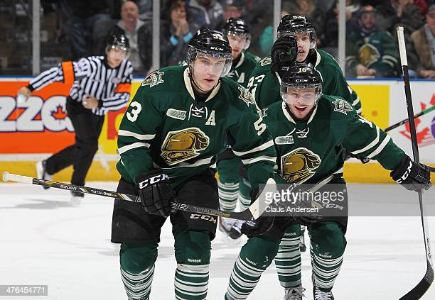 Bo Horvat and Max Domi of the London Knights head back to the bench after Horvat's goal against the Peterborough Petes during an OHL game at the...