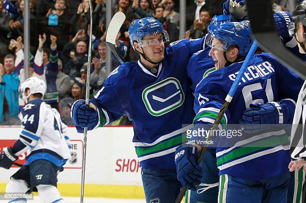 Bo Horvat and Troy Stecher congratulate Sven Baertschi of the Vancouver Canucks who scored on a breakaway against the Winnipeg Jets during their NHL...