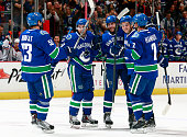 Bo Horvat Dan Hamhuis Jake Virtanen and Sven Baertschi congratulate Matt Bartkowski who scored his first goal for the Vancouver Canucks against the...