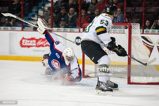 Bo Horvat of the London Knights fires a shot against Dalen Kuchmey of the Windsor Spitfires for a goal in Game 3 of their OHL QuarterFinal series on...