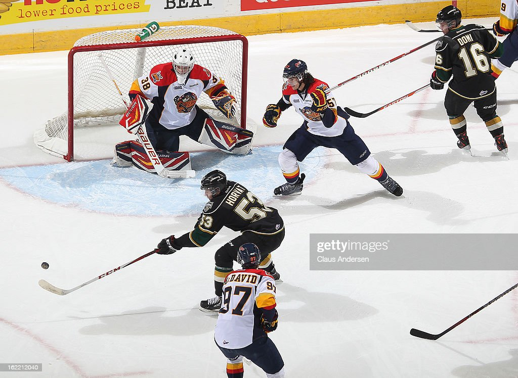 Bo Horvat #53 of the London Knights gets set to fire a shot at <a gi-track='captionPersonalityLinkClicked' href=/galleries/search?phrase=Oscar+Dansk&family=editorial&specificpeople=8613152 ng-click='$event.stopPropagation()'>Oscar Dansk</a> #38 of the Erie Otters in an OHL game on February 18, 2013 at the Budweiser Gardens in London, Canada. The Knights defeated the Otters 8-1.