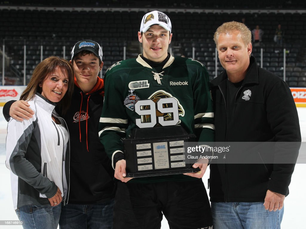 Bo Horvat #53 of the London Knights poses with the Wayne Gretzky playoff MVP trophy and his family after defeating the Barrie Colts in Game Seven in the 2013 OHL Championship Final on May 13, 2013 at the Budweiser Gardens in London, Ontario, Canada. The Knights defeated the Colts 3-2.