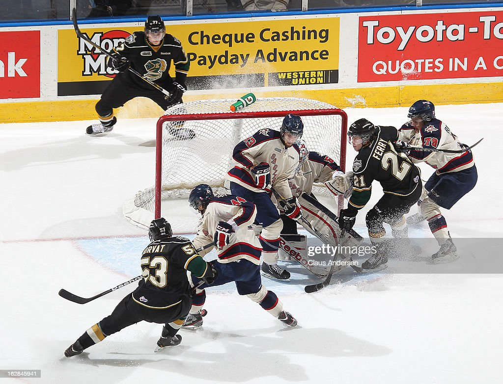 Bo Horvat #53 of the London Knights tries to get a shot through a crowd in an OHL game against the Saginaw Spirit on February 24, 2013 at the Budweiser Gardens in London, Ontario, Canada. The Knights defeated the Spirit 3-2.