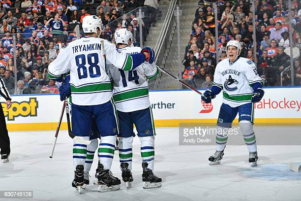 Bo Horvat of the Vancouver Canucks celebrates a goal With teammates Nikita Tryamkin and Alex Burrows during the game against the Edmonton Oilers on...