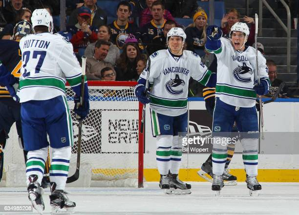 Bo Horvat of the Vancouver Canucks celebrates his redirect goal against the Buffalo Sabres with teammates Markus Granlund and Ben Hutton during an...