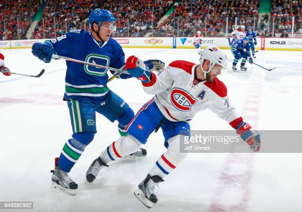 Bo Horvat of the Vancouver Canucks checks Andrei Markov of the Montreal Canadiens during their NHL game at Rogers Arena March 7 2017 in Vancouver...
